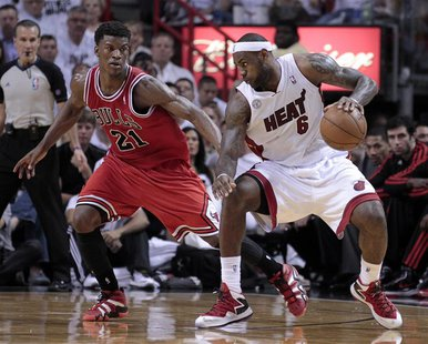 Miami Heat small forward LeBron James (6) is guarded by Chicago Bulls small forward Jimmy Butler (21) in the second half during Game 1 of th