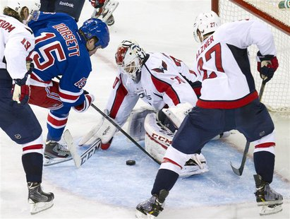 Washington Capitals goalie Braden Holtby (70) stops a shot by New York Rangers right wing Derek Dorsett (15) in the third period of Game 3 o