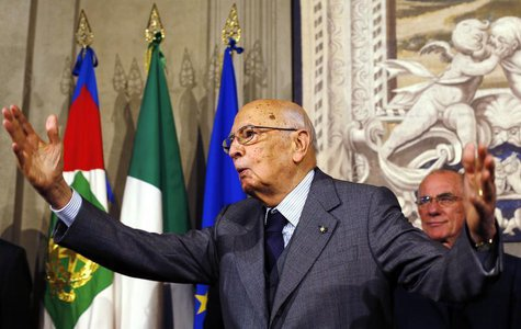Italian President Giorgio Napolitano gestures after a news conference at the Quirinale Palace in Rome, April 27, 2013. REUTERS/Alessandro Bi