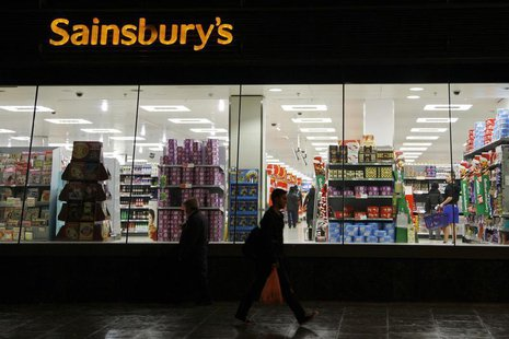 People walk past a Sainsbury's store in south London November 11, 2009. REUTERS/Stefan Wermuth