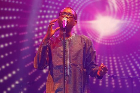 "Singer Youssou N'Dour performs at a concert called ""Africa Celebrates Democracy"" that pays tribute to Tunisian youth and the revolution that"
