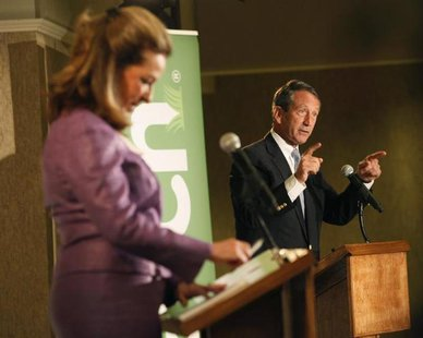 Former South Carolina Governor Mark Sanford makes a point to the moderators during a debate with Democrat Elizabeth Colbert Busch in Charles