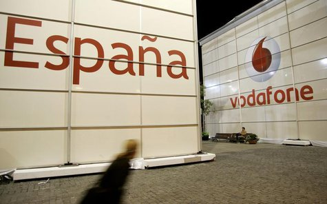 A visitor walks in front of the Vodafone stand during the 3GSM World Congress at the Feria of Barcelona, in central Barcelona February 12, 2