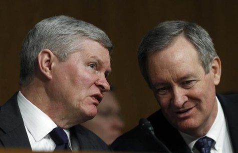 Senate Banking, Housing and Urban Affairs Committee Chairman Tim Johnson (L) (D-SD) talks with Senator Mike Crapo (R-ID) during Federal Rese
