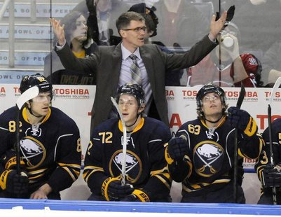 Buffalo Sabres interim head coach Ron Rolston (top) reacts to a penalty during the second period of their NHL hockey game against the Montre