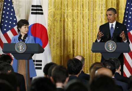 U.S. President Barack Obama (R) gestures as he and South Korea's President Park Geun-hye address a joint news conference in the East Room of