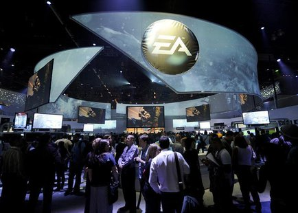 Attendees at the Electronic Entertainment Expo visit the Electronic Arts booth on the first day of E3 in Los Angeles, California June 5, 201