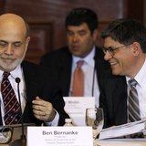 Treasury Secretary Jack Lew (R) and Chairman of the Federal Reserve Bank Ben Bernanke (L) attend the Treasury Department's Financial Stabili