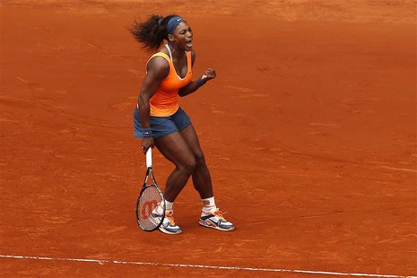 Serena Williams of the U.S. celebrates her victory against Lourdes Dominguez Lino of Spain during their women's singles match at the Madrid
