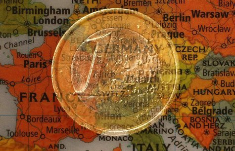A picture illustration taken with the multiple exposure function of the camera shows a one Euro coin and a map of Europe, January 9, 2013. R