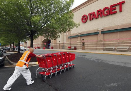 A Target employee returns carts to the store in Falls Church, Virginia May 14, 2012. Target Corp. (TGT) will report its first quarter result