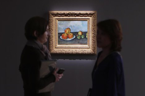 Visitors talk near Paul Cezanne's 'Les Pommes,' estimated between $25-35 million, during a preview of Sotheby's May 7 Impressionist and Mode