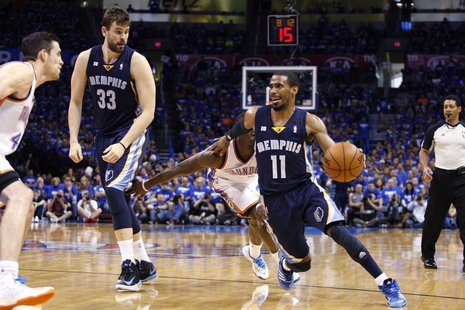 Memphis Grizzlies guard Mike Conley (R) drives against the Oklahoma City Thunder in the second half of their Game 1 NBA Western Conference s