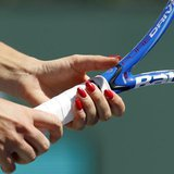 Agnieszka Radwanska of Poland grips her racquet as she receives serve from Elena Dementieva of Russia during their match at the Indian Wells