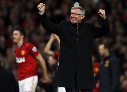 Manchester United's manager Alex Ferguson celebrates after his team clinched the English Premier League soccer title with a win against Asto