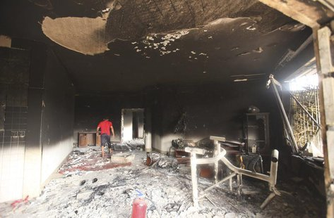 A man walks inside the U.S. consulate, which was attacked and set on fire by gunmen yesterday, in Benghazi September 12, 2012. REUTERS/Esam
