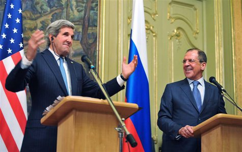 U.S. Secretary of State John Kerry (L) and Russian Foreign Minister Sergei Lavrov take part in a joint news conference after their meeting i
