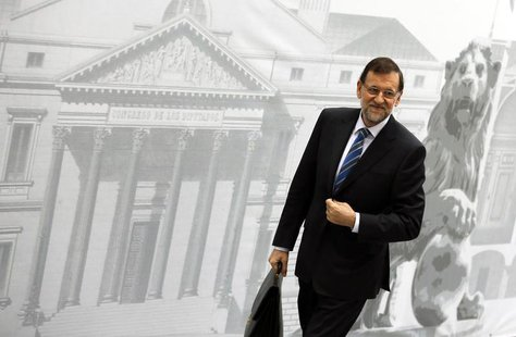 Spain's Prime Minister Mariano Rajoy smiles as he arrives at Parliament to present a new reform program during a session in Madrid May 8, 20