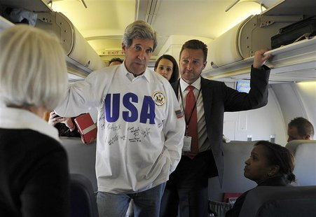 U.S. Secretary of State John Kerry (C) talks to journalists on board his plane after his departure from Moscow May 8, 2013. REUTERS/Mladen A