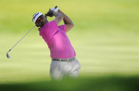 Fiji's Vijay Singh watches his shot on the 16th hole during first round play in the Arnold Palmer Invitational PGA golf tournament in Orland