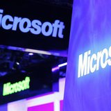 A variety of logos hover above the Microsoft booth on the opening day of the International Consumer Electronics Show (CES) in Las Vegas Janu