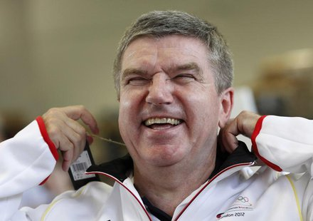 German Olympic Sports Confederation (Deutscher Olympischer Sportbund, DOSB) President Thomas Bach laughs during the kitting out session for