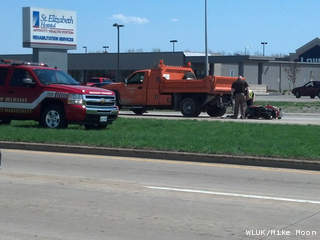 Emergency crews respond to a crash between a moped and an Outagamie County truck on Hwy. CE east of Appleton, May 8, 2013. (courtesy of FOX 11).