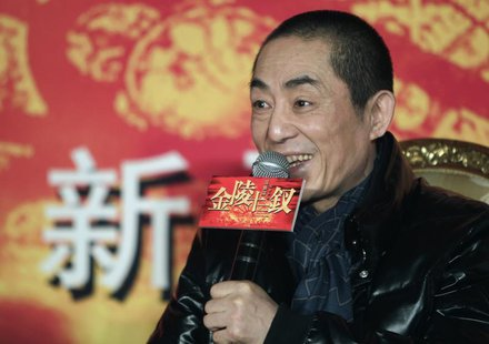 "Chinese director Zhang Yimou answers a question during a news conference for his new movie ""the 13 Women of Nanjing"" (the city also known as"