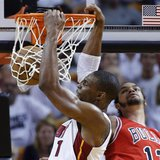 Miami Heat's Chris Bosh (L) slam dunks over Chicago Bulls' Joakim Noah during Game 2 of their NBA Eastern Conference semi-final basketball p