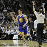 Golden State Warriors guard Klay Thompson reacts after hitting a three-point shot against the San Antonio Spurs during the second half of th
