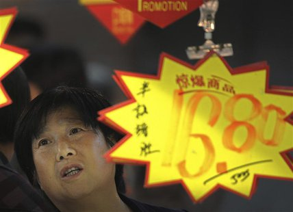 A customer looks at price tags at a supermarket in Hefei, Anhui province, May 9, 2013. REUTERS/Stringer