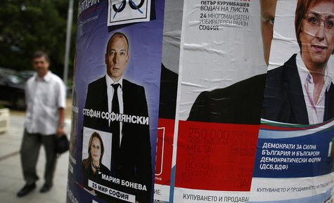 A man walks past political election posters in central Sofia May 8, 2013. REUTERS/Stoyan Nenov