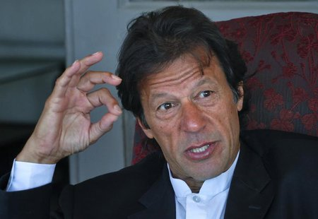 Imran Khan, Pakistani cricketer turned politician, speaks during an interview at his residence in Islamabad November 16, 2011. REUTERS/Mian