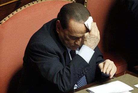 People of Freedom (PDL) party member and former Prime Minister Silvio Berlusconi wipes his forehead as he attends the Upper house of the par