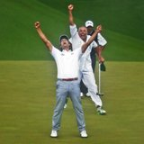 Adam Scott of Australia (L) celebrates winning the Masters with caddie Steve Williams (C) in front of Angel Cabrera of Argentina (R) on the