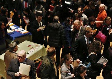 People wait in line to meet a job recruiter at the UJA-Federation Connect to Care job fair in New York March 6, 2013. REUTERS/Shannon Staple