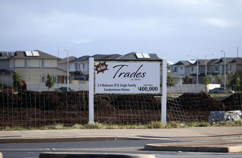 A sign near the Trades housing division built by Gentry Homes promotes special offers for potential buyers in Ewa Beach, Hawaii, March 6, 20