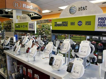 AT&T mobile phones are seen for sale alongside T-Mobile phones at a RadioShack electronics store in Los Angeles August 31, 2011. REUTERS/Dan