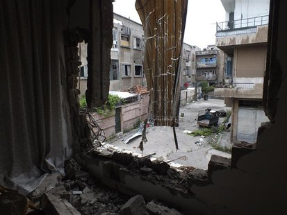 A view of a street seen from a damaged balcony in the Khaldiyeh district in central Homs May 9, 2013. REUTERS/Yazan Homsy