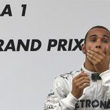 Mercedes Formula One driver Lewis Hamilton of Britain reacts on the winners' podium during the victory ceremony after the Chinese F1 Grand P