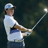 Rory McIlroy of Northern Ireland watches his approach shot on the 14th hole during the first round of The Players Championship PGA golf tour