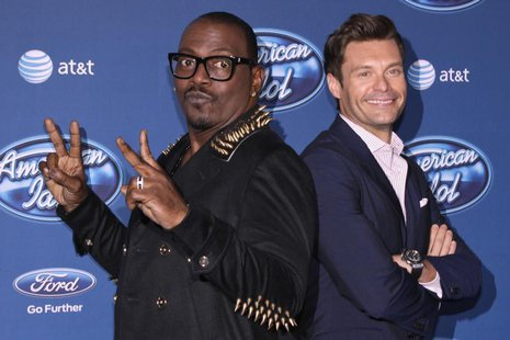 Musician and producer Randy Jackson (L) and TV and radio personality Ryan Seacrest arrive for the American Idol Season 12 premiere event at