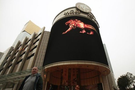 A visitor walks past the MGM Grand Macau resort in Macau February 15, 2011. REUTERS/Tyrone Siu
