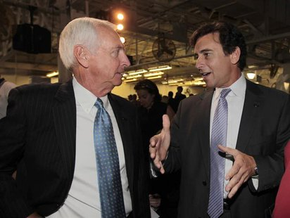 Kentucky Governor Steve Beshear (L) talks with Ford Motor Company's Mark Fields (R), Ford's president of the Americas, during a news confere