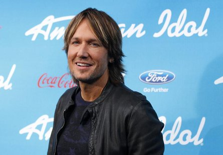 "Country singer and judge Keith Urban poses at the party for the finalists of the television show ""American Idol"" in Los Angeles, California"