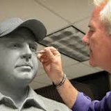 Bill Wolfe works on Brent Long Statue In Clay before being cast in bronze