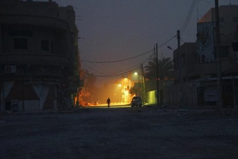 A man walks along a deserted street in Deir al-Zor April 8, 2013. REUTERS/ Khalil Ashawi
