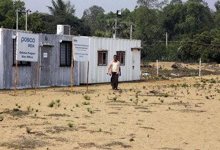 A villager walks at the POSCO India Odisha Project site office at Gobindpur village in Jagatsinghpur district, in the eastern Indian state o