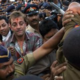 Bollywood actor Sanjay Dutt (C, with red mark on forehead), surrounded by Indian policemen, leaves a special court after getting bail in Mum