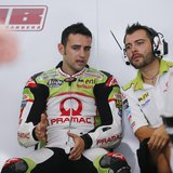 MotoGP rider Hector Barbera of Spain (L) speaks to his mechanic during a free practice session ahead of the Malaysian Grand Prix in Sepang O